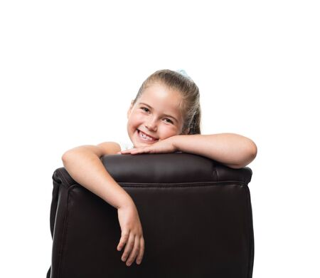 lean on hands: lean on back of the black office armchair and smiling