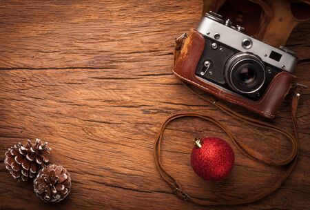 old items: composition of old fasioned photocamera ans xmas items on old wooden table Stock Photo