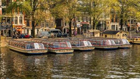 Five cruise boats on the pier in Amsterdam