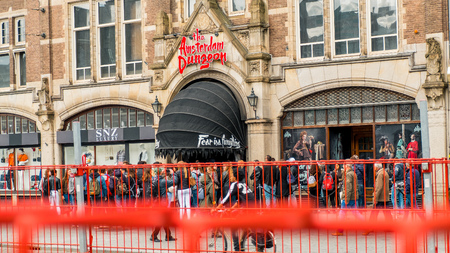 People are waiting for the entrance to the Amsterdam dungeons, a popular attraction for tourists