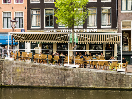 Cafe-bar Trinity in Amsterdam on a cold spring day Редакционное