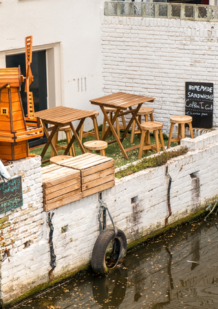 A small street cafe in Amsterdam, a view of the canal.