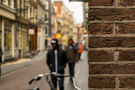 Man on a blurry background in Amsterdam