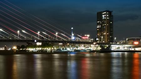 Rotterdam, The Netherlands - May 2017: Erasmusbrug bridge at night by Noordereiland Редакционное