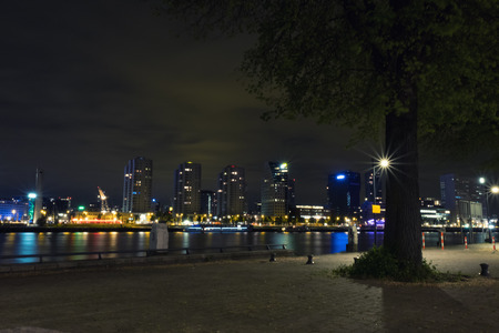 Rotterdam, The Netherlands - May 2017: Boompjeskade at night from the island of Noordereiland