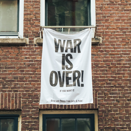 The war is over, if you want it, the banner on the wall of the house in Amsterdam. May 2017.