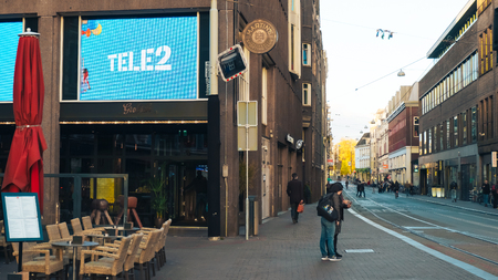 Amsterdam, The Netherlands - May 10, 2017. Advertising Tele2 in the city center.