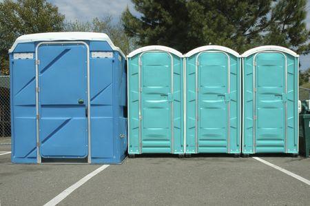 Row of portable toilets in Folsom , CA. Imagens