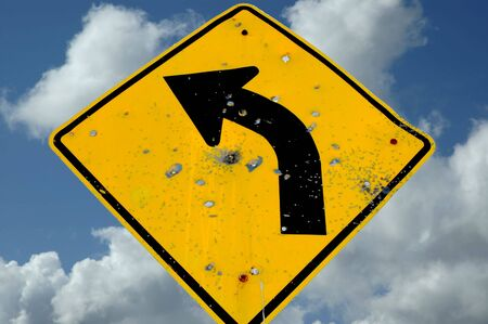 gunfire: Road Sign with Bullet Holes, Sutter Buttes California, USA