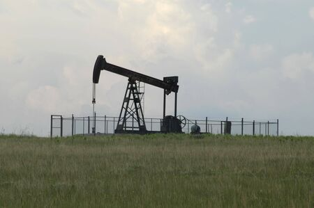 Oil Well Pump And Field In Oklahoma Stock Photo - 2824135