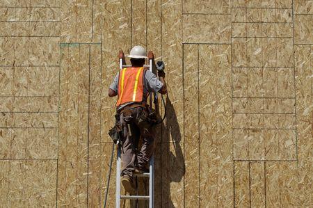 Construction Worker Using Nail Gun 版權商用圖片