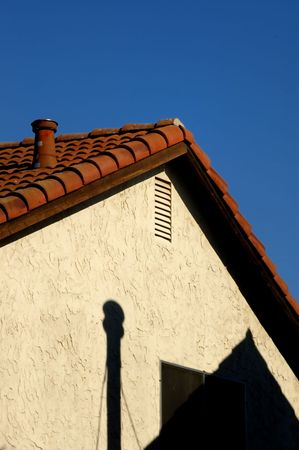 Detail of the roof and chimney of a house Stock Photo - 3207711