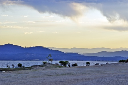Folsom Lake With Sierra Nevada Mountains In Far Backgound Stock Photo