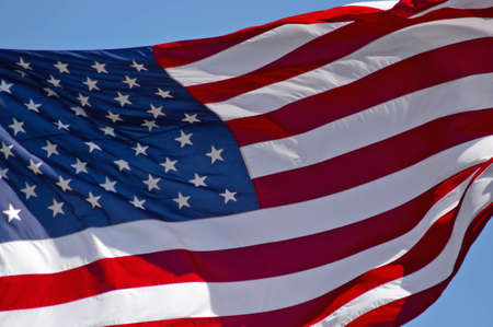 The American Flag Flowing In The Wind Stock Photo