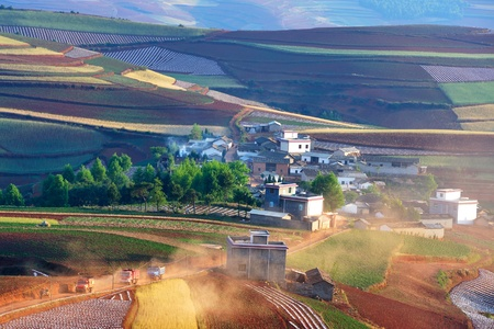 China rural landscape on colorful red land in Yunnan Province, southwest of China Stock Photo - 8297548
