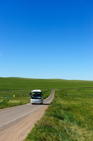 tour bus: Bus in Hulun Buir grassland of Inner-Mongolia, China