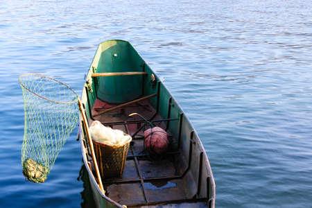 chinese fishing nets: Fishing boat on the lake Stock Photo