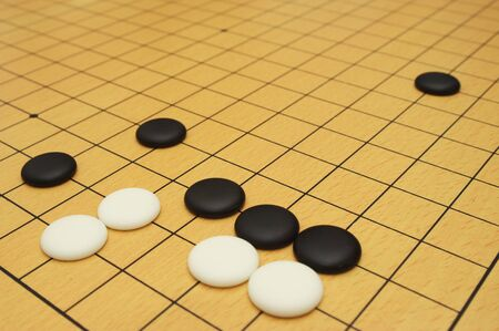 blockade: Go game board with black and white stones