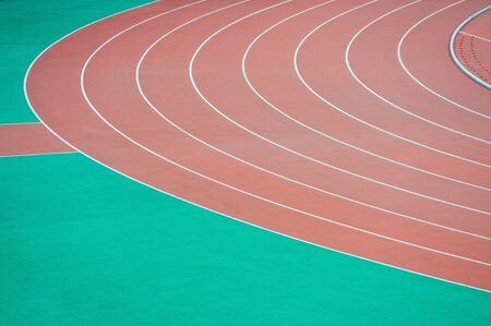 Red curve athletics running track photo