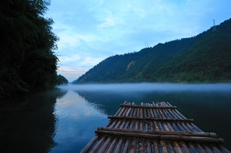 River landscape at sunset with fog rolling across the chilly river water, photo taken in Hunan province of China photo