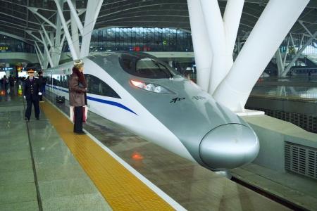 Guangzhou, China - Jannuary 19, 2011: High speed train stops at Guangzhou south railroad station on JAN 21, 2011 in Guangzhou city, China