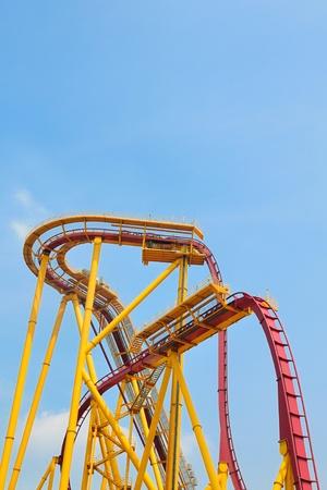 Roller coaster in amusement park under blue sky photo