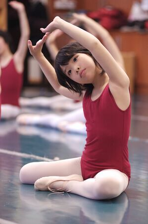 Asian kid dancing Stock Photo - 9290475
