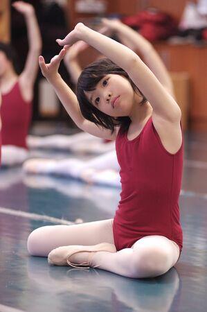 Asian kid dancing photo