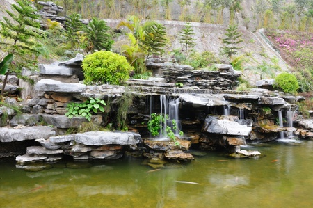 garden pond: Chinese rockery garden with pond and waterfall