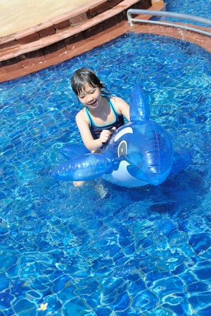 Asian kid playing in the swimming pool Stock Photo - 9379949
