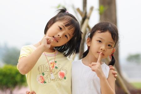 Portrait of two happy asian little kids photo