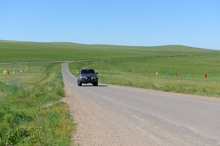 SUV moving in Hulun Buir grassland of Inner-Mongolia, China photo