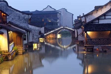 Night scene of traditional building near the river in Wuzhen town, Zhejiang province, China photo