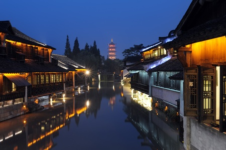 asian house plants: Night scene of traditional building near the river in Wuzhen town, Zhejiang province, China