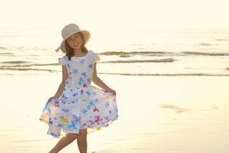 Portrait of an Asian kid playing on the beach photo