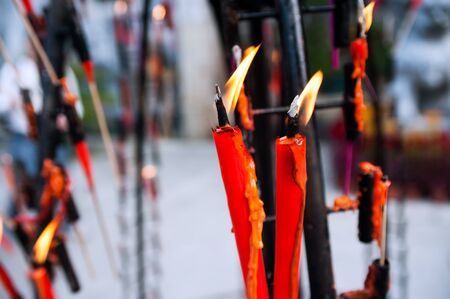 Burning incense candles in Chinese buddhist temple photo