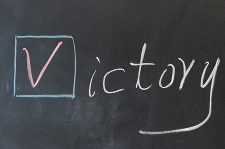 Chalkboard writing - Victory word in Egnlish Stock Photo - 11623075