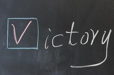 Chalkboard writing - Victory word in Egnlish Stock Photo - 11623075