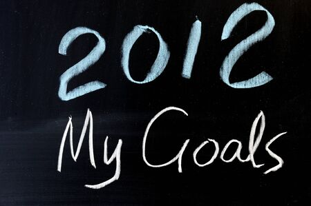 intentions: Chalkboard drawing - 2012 new year plans Stock Photo