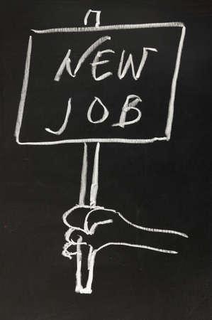 Chalk drawing - hand holding a board writingnew job photo