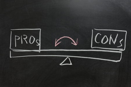 Chalkboard drawing - Measure of Pros and Cons photo