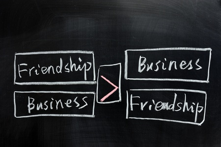 Chalk drawing - Relationship between friendship and business Stock Photo - 11873408