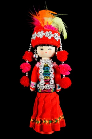 Chinese traditional style doll in red dress isolated on black