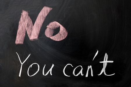 cant: Chalk drawing -No you cant written on chalkboard Stock Photo