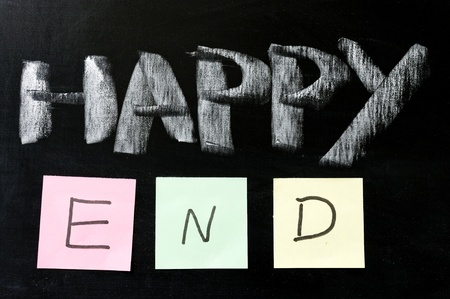 the end: Chalk drawing - Happy end written on chalkboard Stock Photo