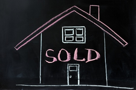 conceptional: Chalk conceptional drawing - House sold Stock Photo