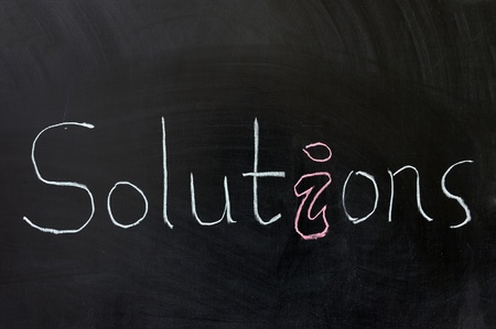 Chalk drawing - Solutions word written on chalkboard Stock Photo - 12008907