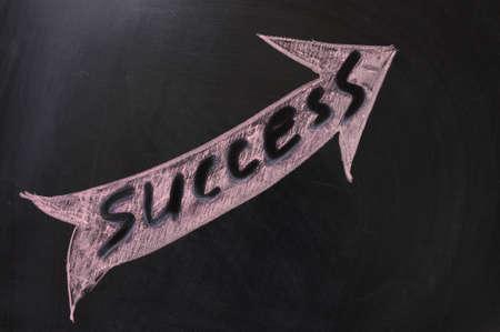 Chalk drawing - Success word written in a arrow Stock Photo - 12701706