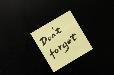 not to forget:  Do not forget  words written on note paper Stock Photo