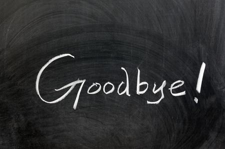farewell: Chalk drawing - Goodbye word written on chalkboard
